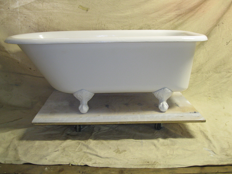 clawfoot bathtub in process of refinishing